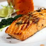 Salmon fillet in spices with spinach and carrot puree